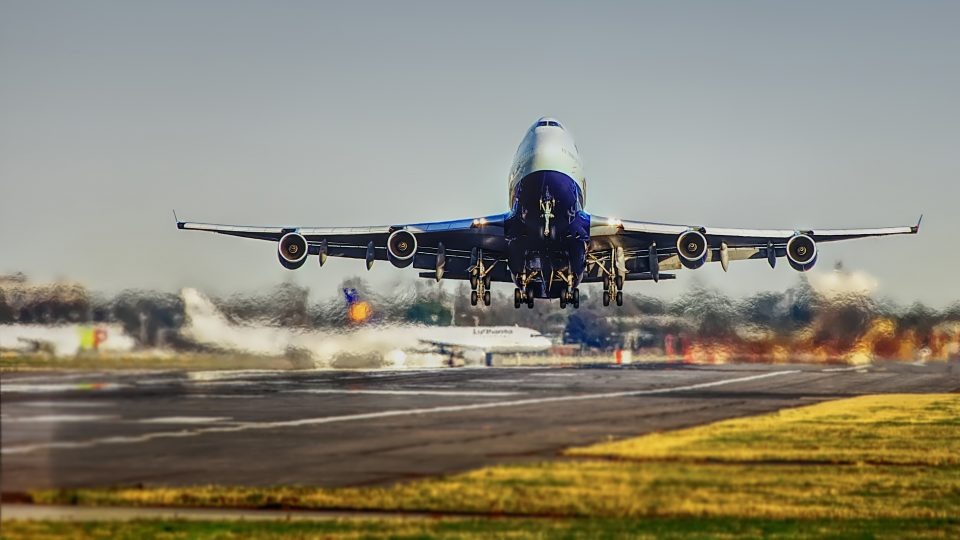 Airplane landing on runway.